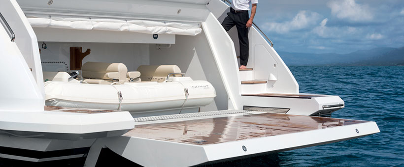 Yacht tender garage with articulated cranes
