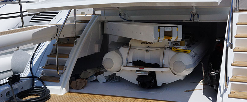 Yacht tender garage with telescopic cranes
